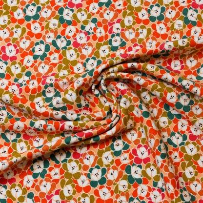 """Poppy - Tissu Jersey de Coton Texturé Imprimé Fleurs """"Floral Moments"""" sur le Fond Orange"""