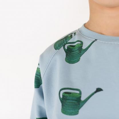 """See You at Six - Tissu Jersey Sweat Léger de Coton Imprimé Arrosoirs """"Watering Cans"""" sur le Fond Bleu Clair"""