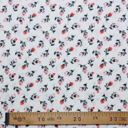 Sélection Coup de coudre - Tissu Jersey de Coton Ajouré Imprimé Roses sur le Fond Blanc