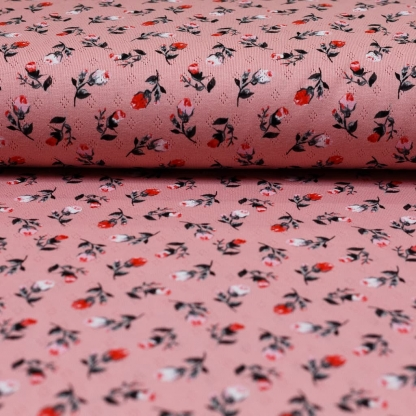 Sélection Coup de coudre - Tissu Jersey de Coton Ajouré Imprimé Roses sur le Fond Rose