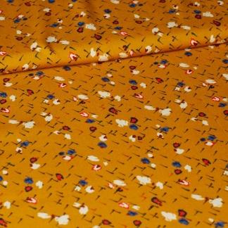 Sélection Coup de coudre - Tissu Popeline de Viscose à Motif Petits Fleurs sur le Fond Ocre